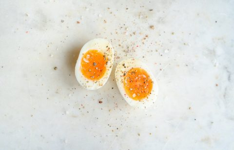 spiced soft boiled egg on marble tabletop